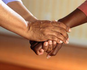 The hands of volunteers.