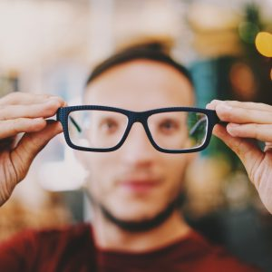 Keeping healthy in the workplace: Man looking through glasses