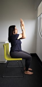 Chair yoga: Eagle arms