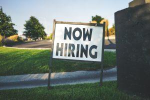 job advert now hiring sign on grass verge